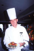 Chef holding plate